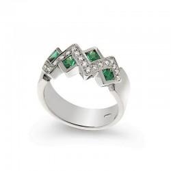 Anillo de oro del diamante y esmeralda
